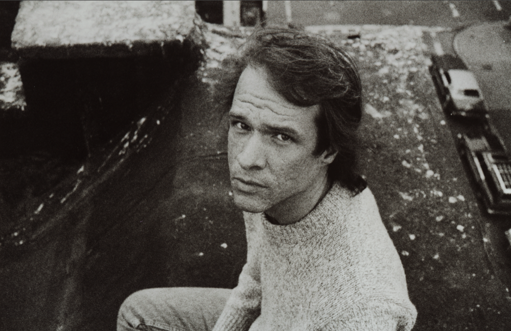 Arthur Russell on the rooftop of 437 East Twelfth Street in mid-1980's. Photograph by Tom Lea