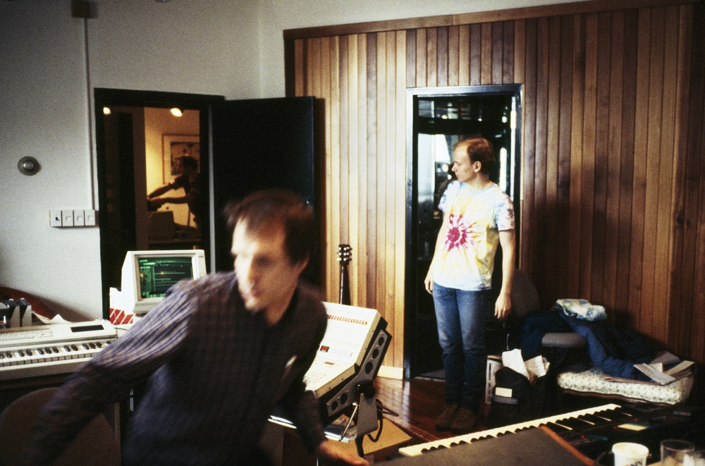 Arthur Russell recording music at Battery Sound in the early 1980s. Eric Muiderman, student of Peter Zummo and an apprentice of Arthur, stands on the right. Mark Freedman works in the adjoining room. Photograph by and courtesy of Peter Zummo.
