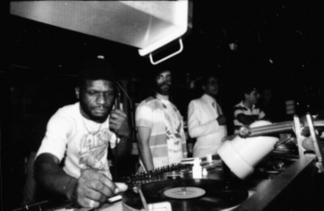 Larry Levan at the Paradise Garage with David Mancuso (centre) and Herbie Hancock (right). Courtesy of Gail Bruesewitz.