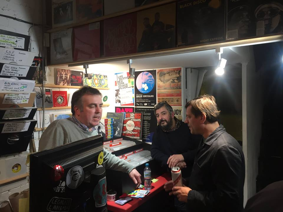 The guys at Love Vinyl--surrounded by the music they love....jpg