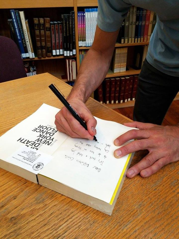 Signing a library book!