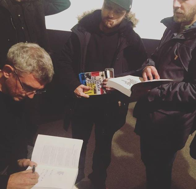 Signing books during my visit to Vilnius. Pic posted on instagram by opiumvilnius. — with Arturas Mamania.