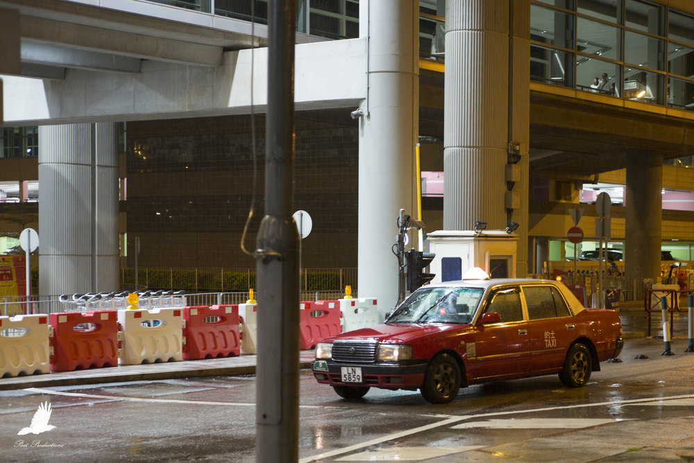 A taxi arrives at Hong Kong Airport
