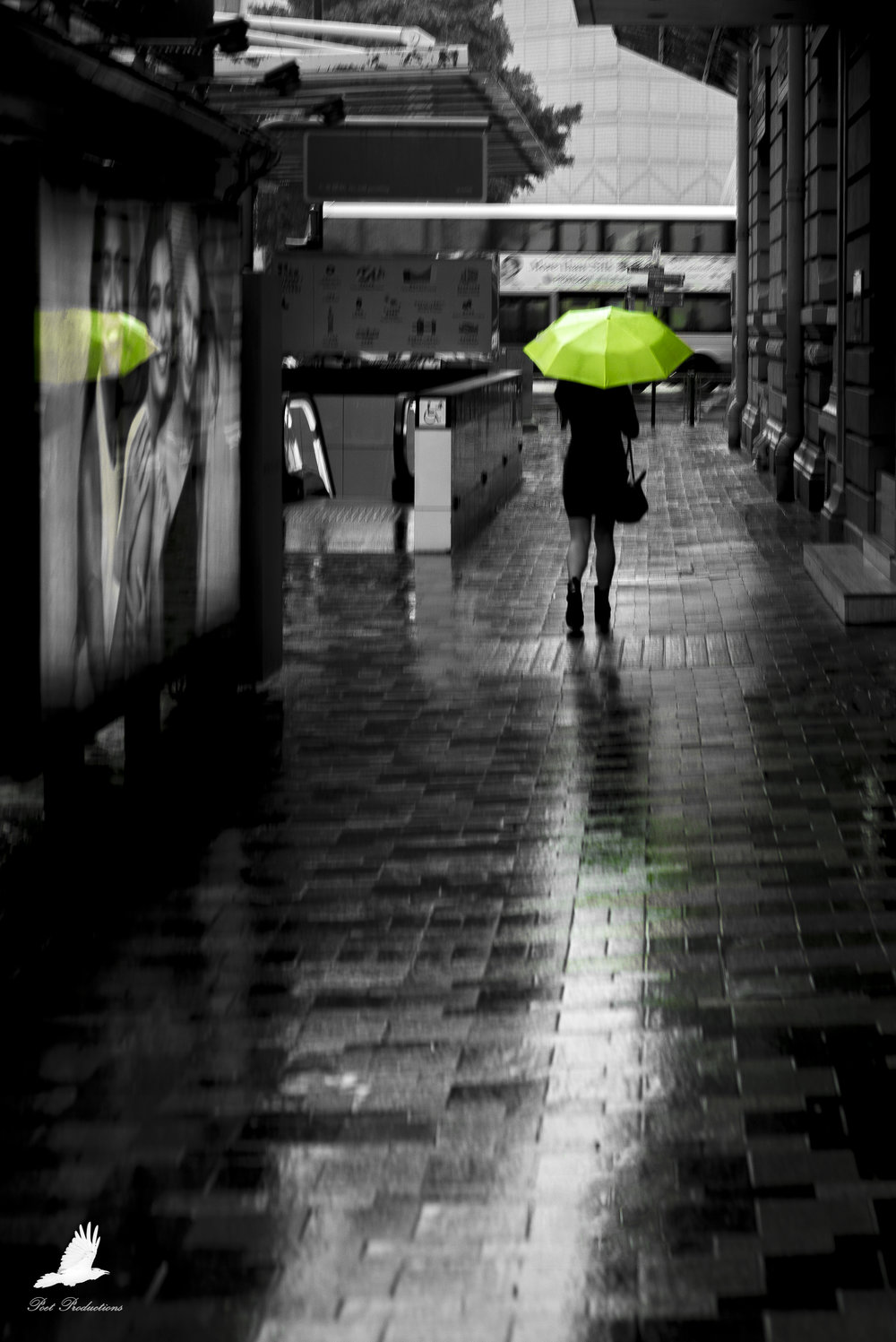 Woman with a lime green umbrella in Hong Kong