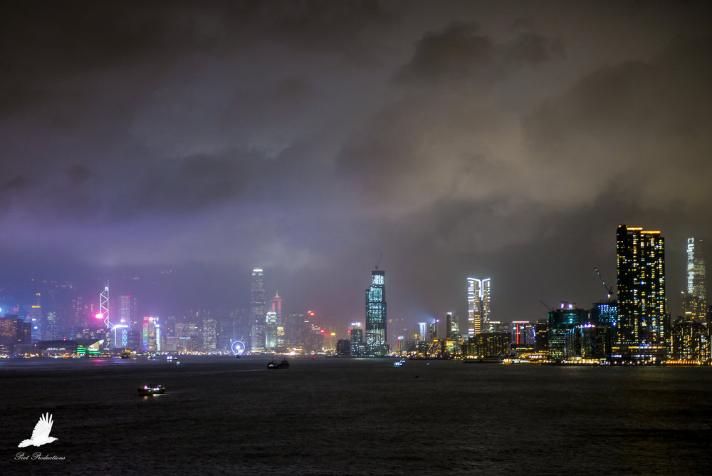 The view of Victoria Harbour and Kowloon Bay from Kai Tak Cruise Terminal, at night