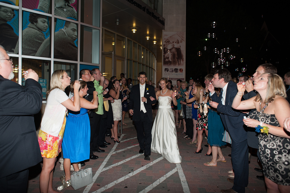 Bride and Groom Walk away with Bubbles