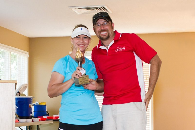 "As a hole sponsor at the Genoa Chamber's Olympics-themed golf tournament, Crown treated golfers to a ""flippy cup"" competition. Winners took home limited edition pub glasses and Crown took home the gold for best game.   image courtesy of JK Richards Photography"
