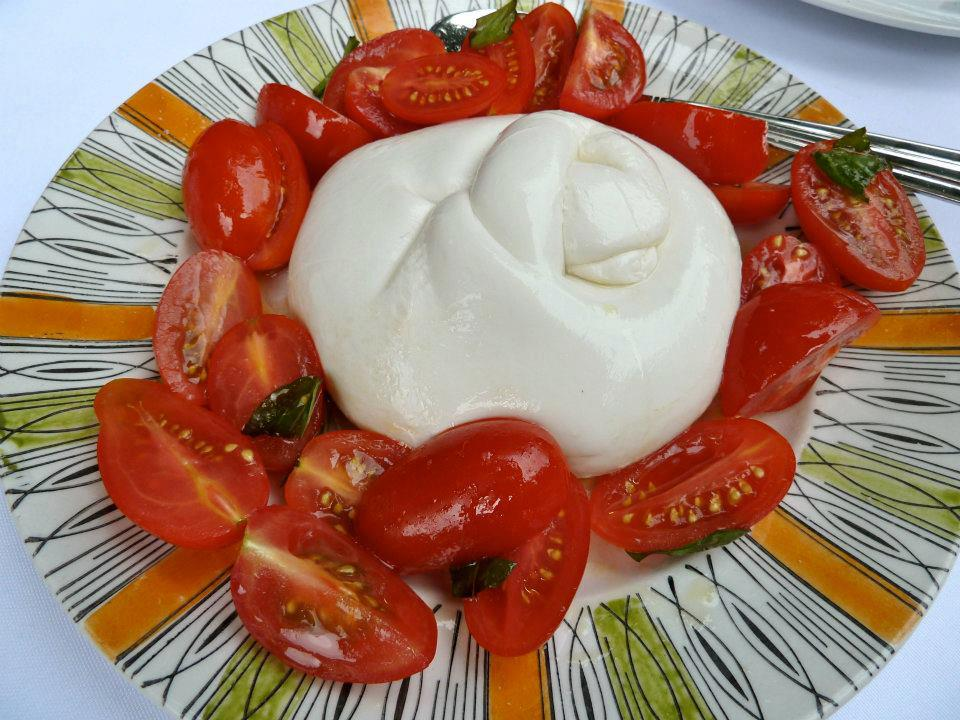 Burrata with cherry tomatoes and basil