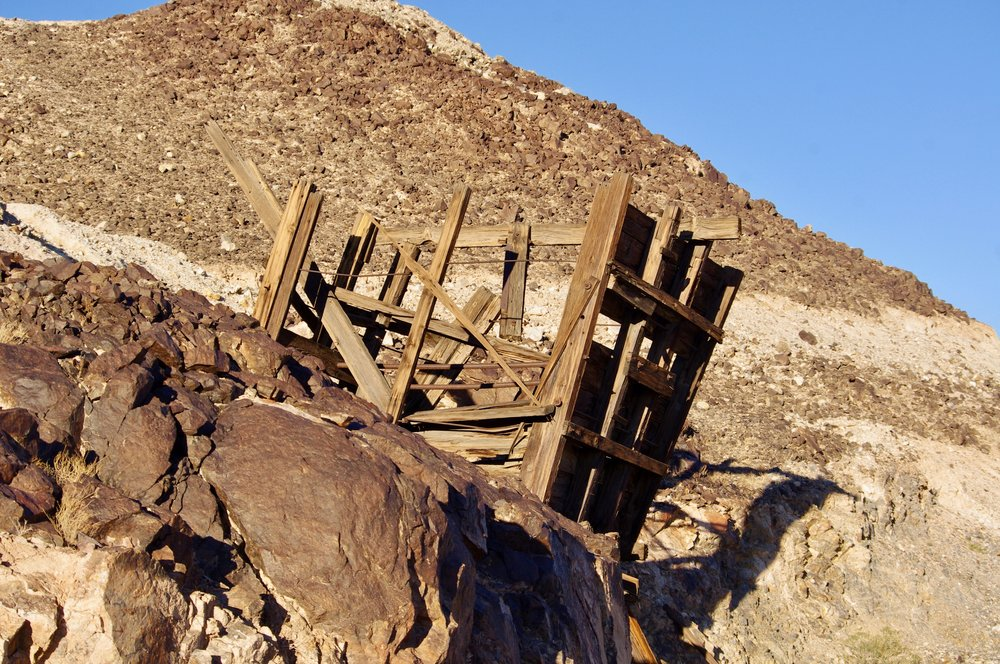 Also at the American Girl mine is this battered wooden structure. It is perched on a hill of what appears to be mining leftovers…gravel and sand and rocks.