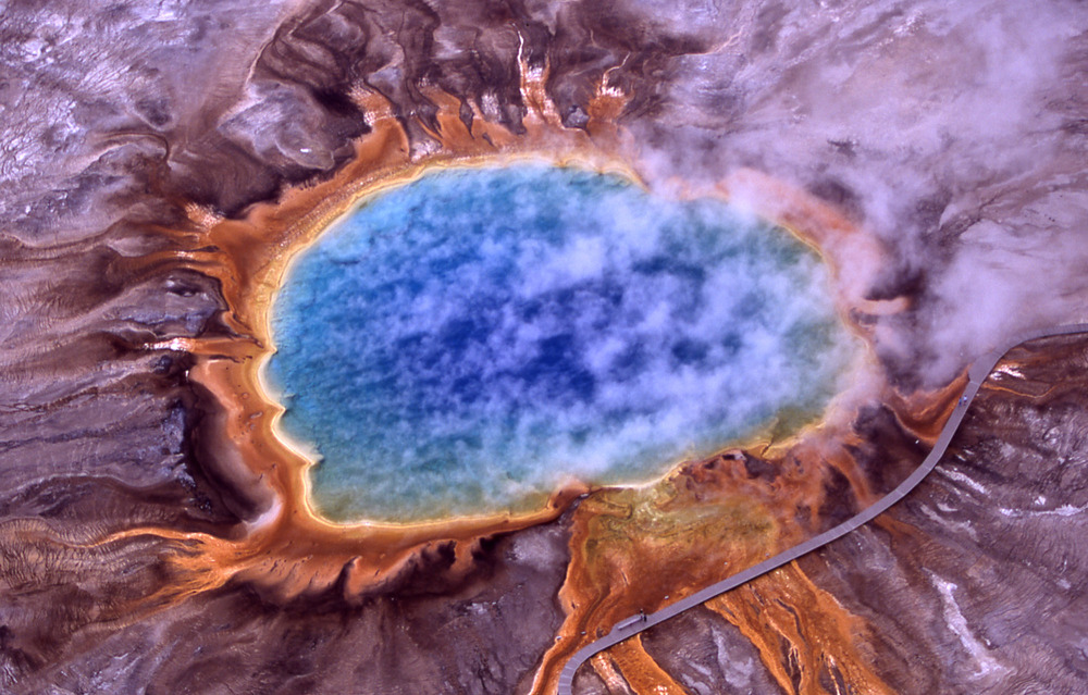 The bright colors you see are produced by extremophiles at  Grand Prismatic Spring ,  Yellowstone National Park . Photo credit: Jim Peaco, National Park Service.