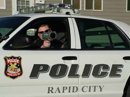 Police officers use radar guns to capture their unsuspecting prey.  Photo courtesy of rcgov.org.