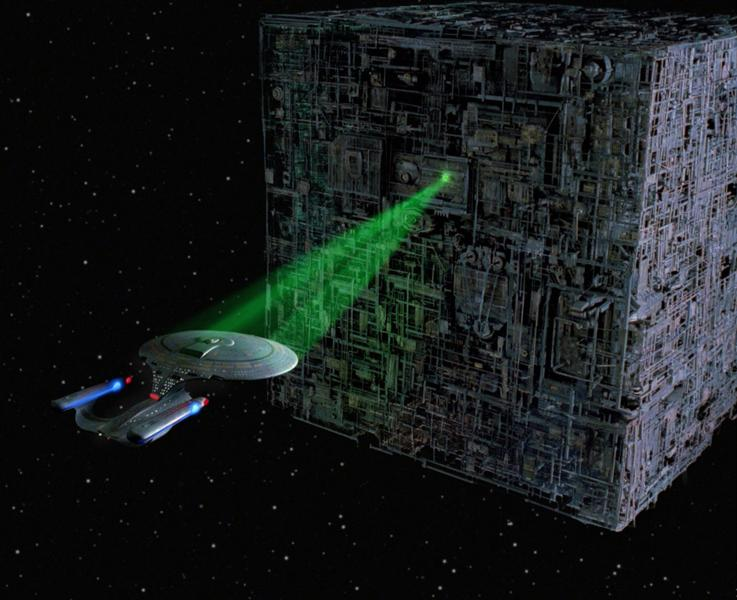 The Enterprise helplessly locked in the Borg's tractor beam.  Image source .