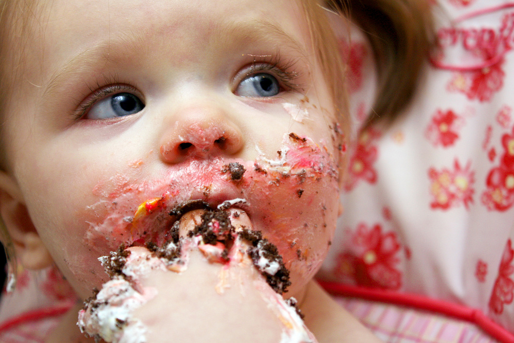 In this study, researchers had subjects eat cake without utensils to get a better idea of how often people touch their faces without realizing. Just kidding. Photo credit: Ella eating her caaake! by Brittany Randolph, cc
