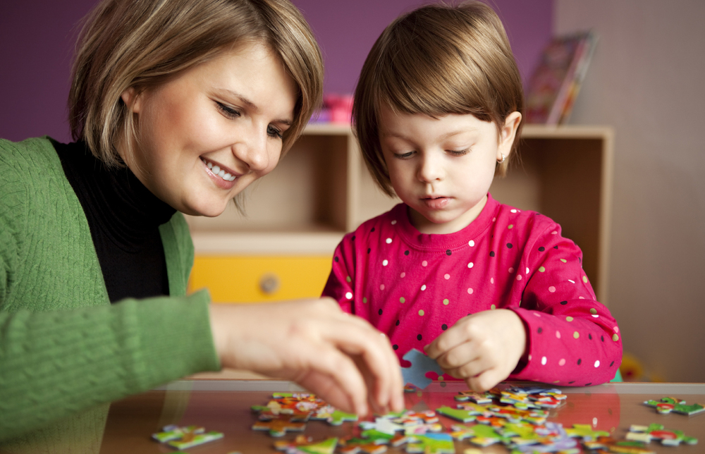 Mother and Daughter playing with puzzles