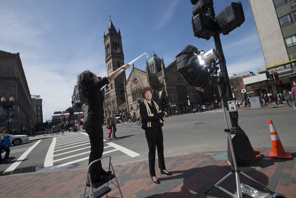 Nancy Taylor, Sr. Minister at South Church ( seen in back), photographed at Copley Sq in Boston, MA for Sports Illustrated.