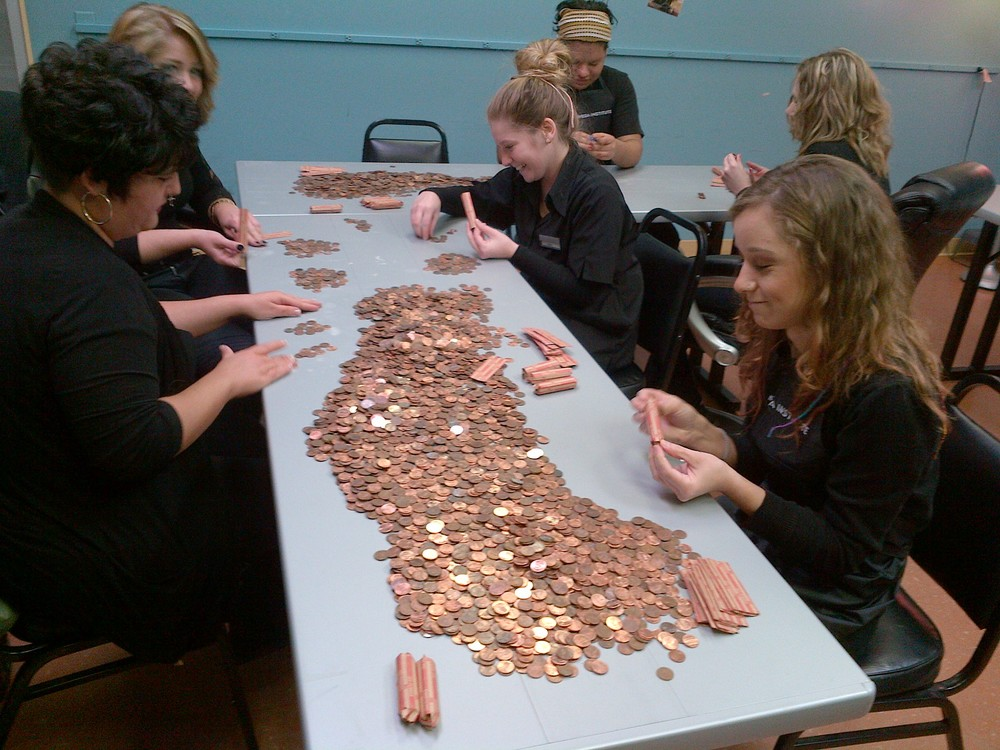 The students taking the time to count all the change for Penny War!