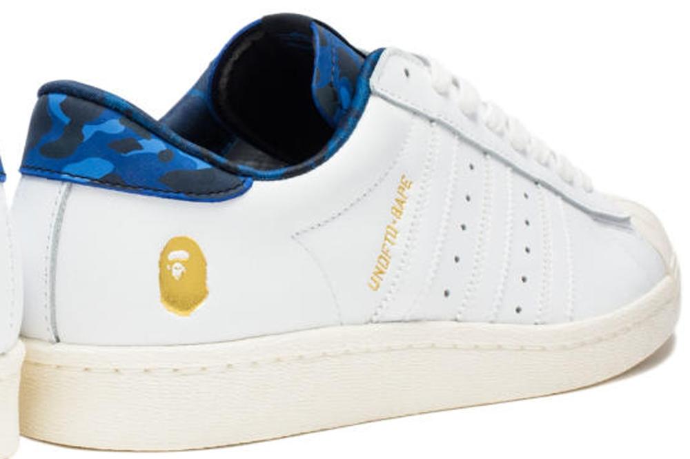 1000_adidas-consortium-superstar-80s-whitegold-blue-camo-1428333674.jpg