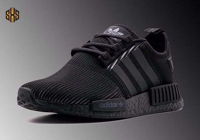 "adidas NMD R1 ""Triple Black"" The ""Triple Black"" continues to be a hit for adidas' Boost-laden models like the adidas NMD. While an all-black version has already released with a basic mesh upper, this brand new version with a ribbed, corduroy-like upper will arrive in stores tomorrow for $140. Thought in these blacked out adidas NMD R1s? Let us know below! #SneakersXSpeakers"