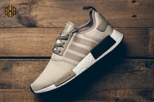 "adidas NMD R1 ""Khaki"" Constructed with stretch mesh, the NMD_R1 arrives in khaki brown, complemented by tonal detailing on the eyestay, stripes and heel tab. The runner is finished off with a full-length, Boost-cushioned sole. Look for these to land at retailers in the upcoming weeks. Thoughts on these NMDs? Let us know below. #SneakersXSpeakers"