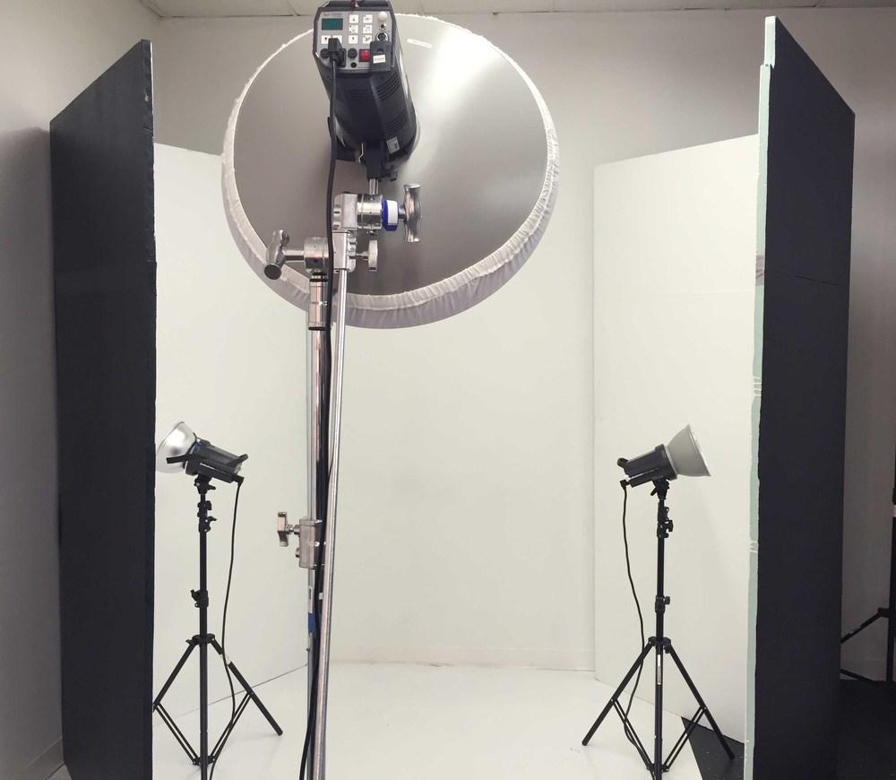 3 studio monolights, 2 V-Flats & a white wall