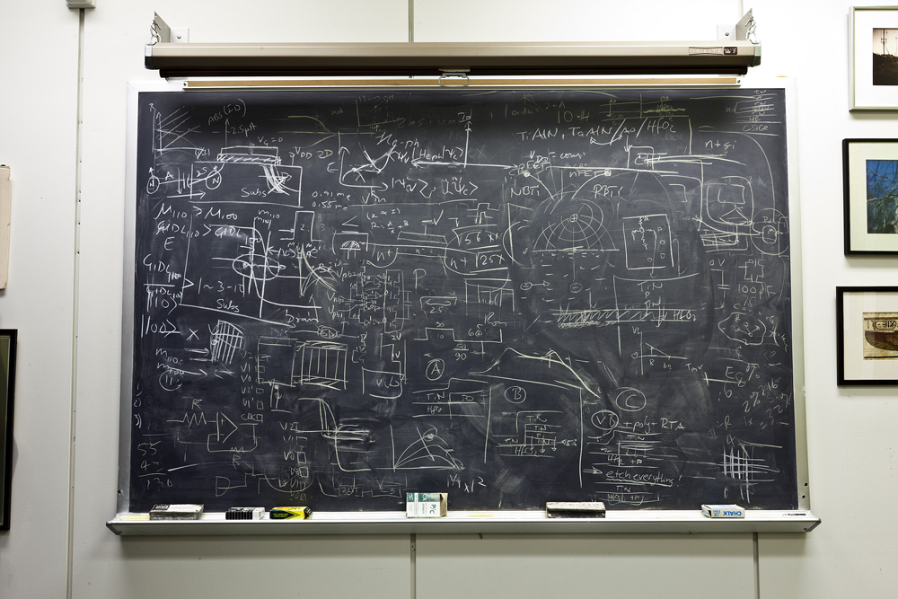 This is Dr. Robert H. Dennard's office blackboard. Dr. Robert H. Dennard, 78, invented dynamic random access memory, or DRAM, in 1966 while working at the Watson Lab. Dennard, an IBM Fellow (1979), was awarded the National Medal of Technology by President Ronald Reagan in 1988. He still comes to work every day at the Yorktown lab where he has worked for over 50 years. Genius is chaotic. (via)