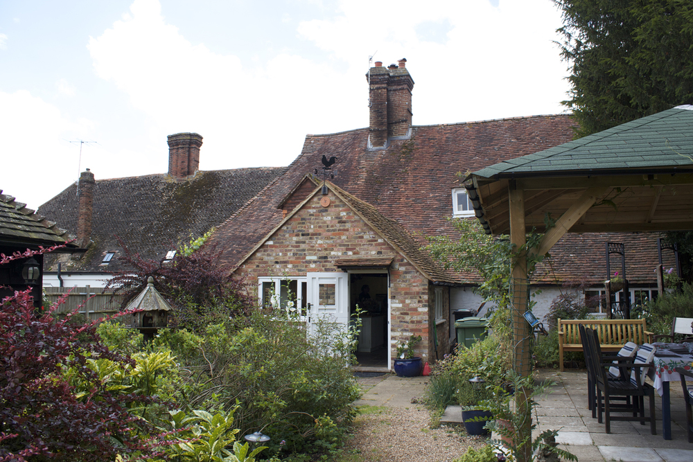 Rear angle view of the property showing setting of extension and main house