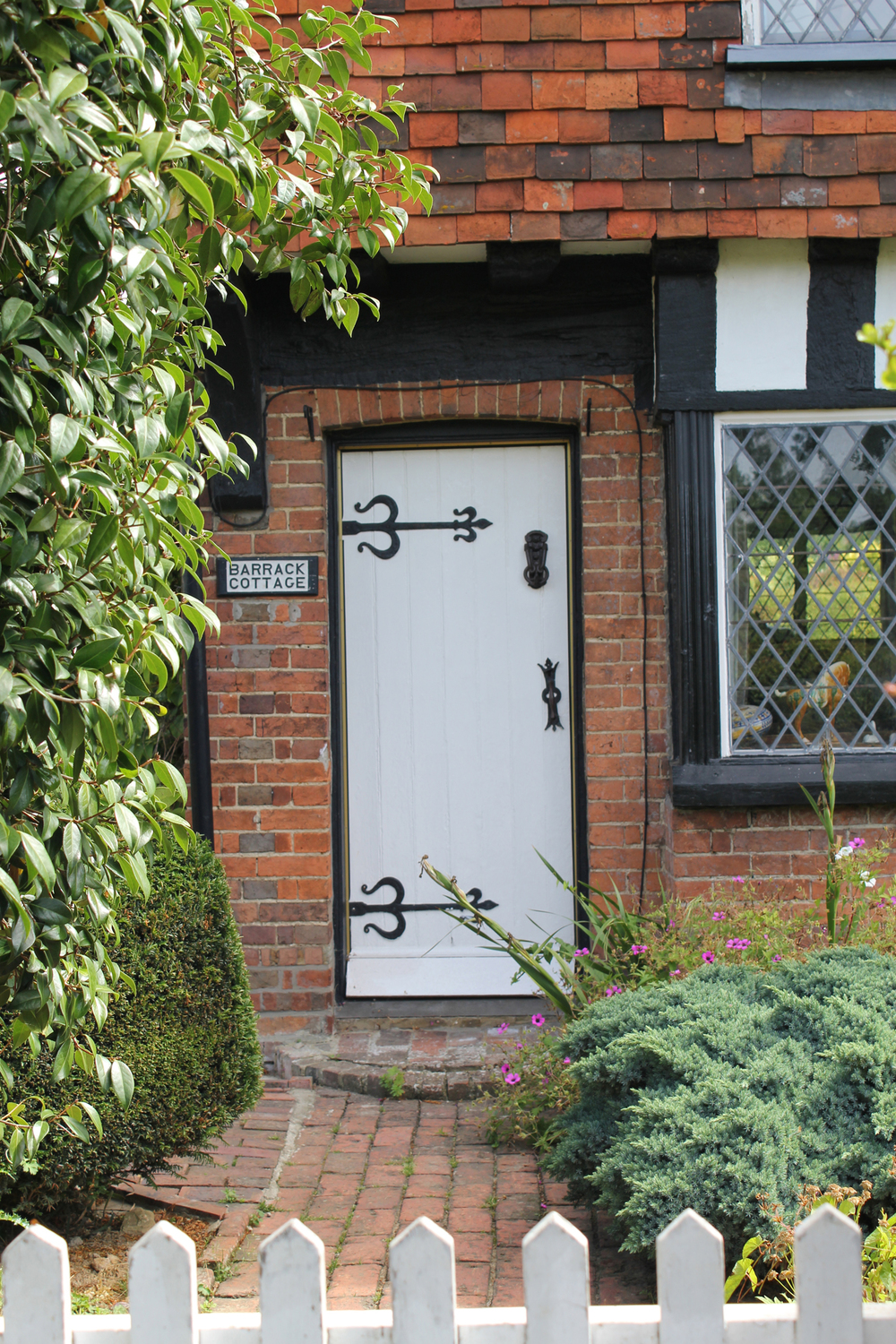 Timber front door with iron detail hinges