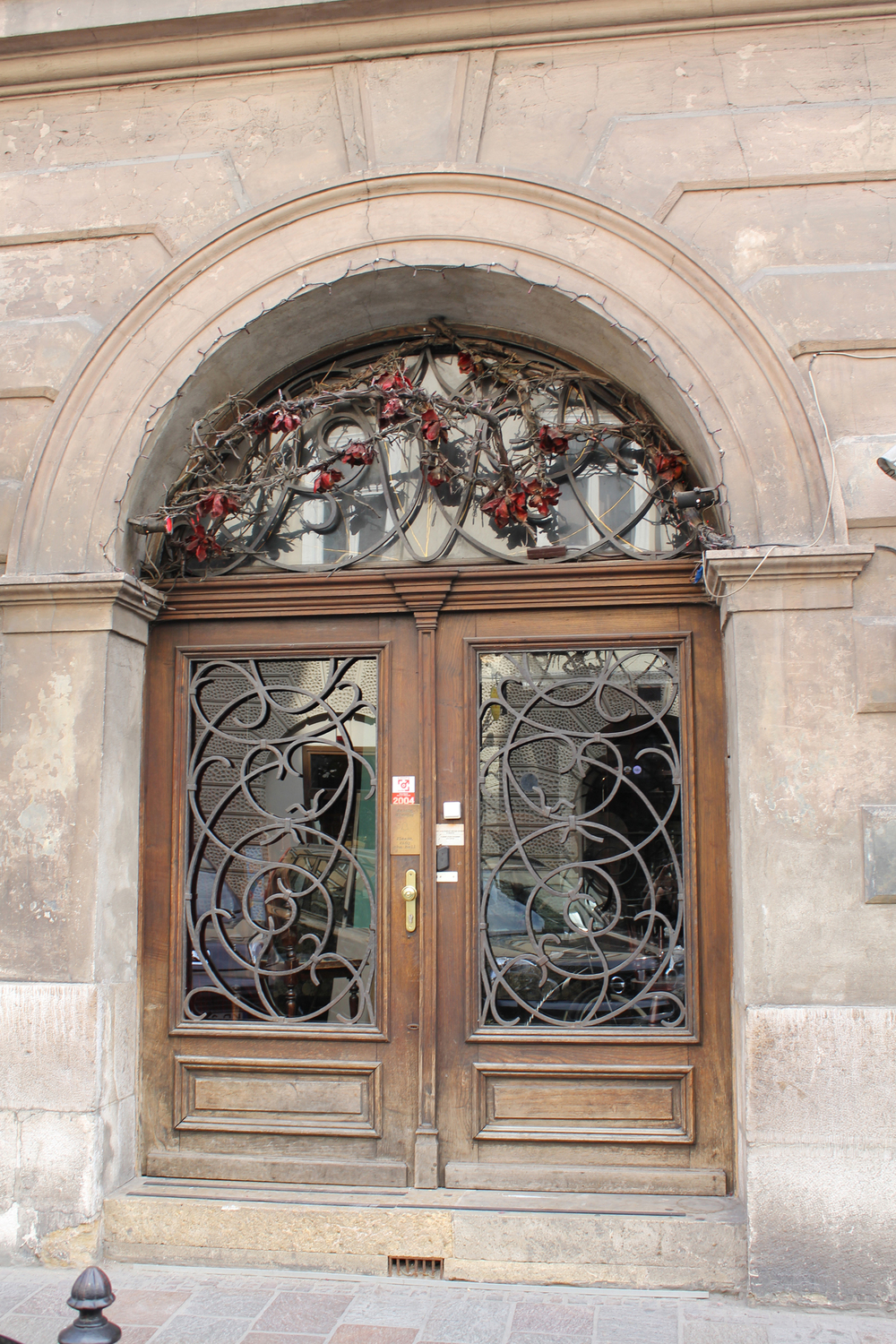 Timber door with intricate ironwork
