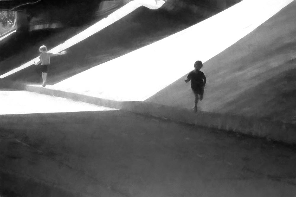 Children playing under the interstate bridge on 10th Street.