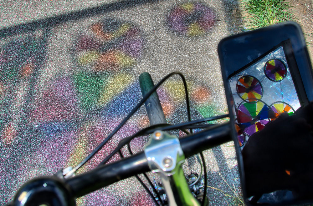 Rainbow wheels shadows and reflection on my iPhone 6SPlus.