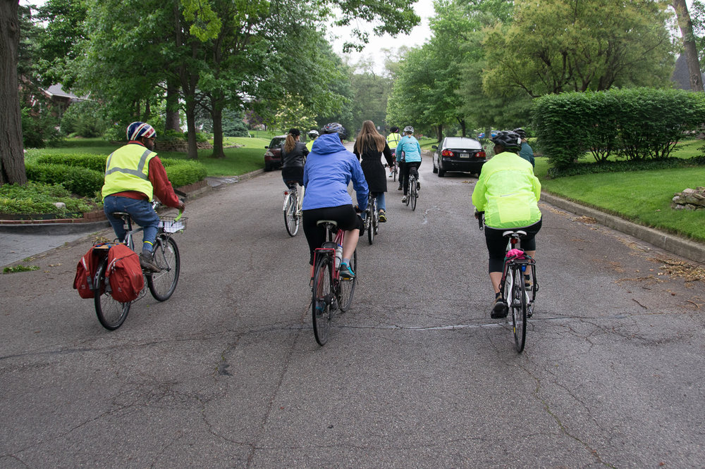 Our tour group cycling through Irvington, led by docent Vicki Hoffman,  middle escort, Harold Thompson, and me, Greg, the photographer/cyclist at the back.