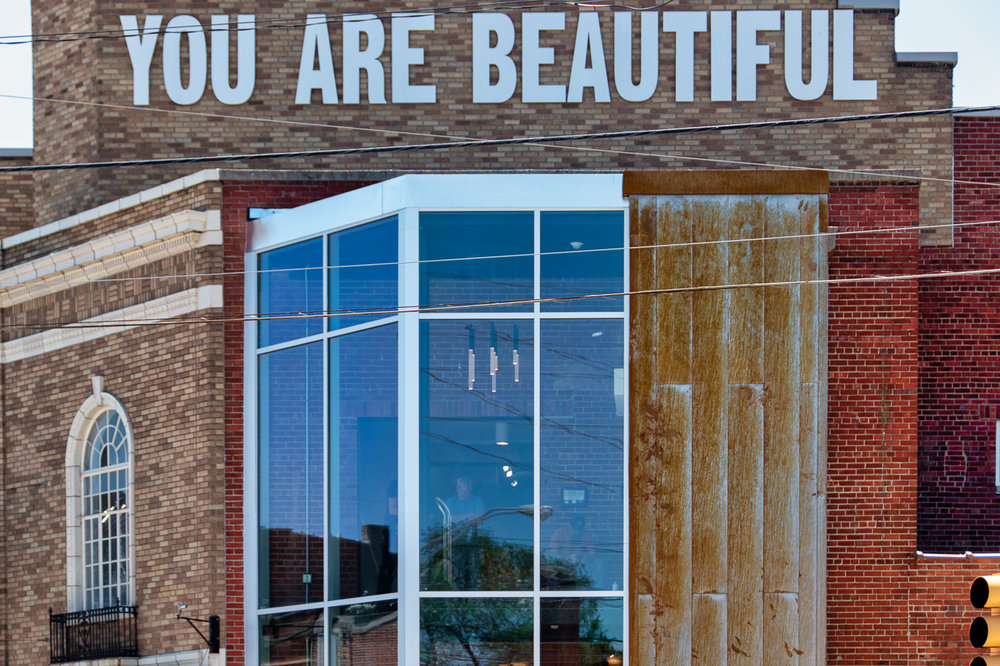 The corner of the Murphy Building in Fountain Square is being renovated with glass panels and beautiful light fixtures inside. The YOU ARE BEAUTIFUL sign has been there for years.
