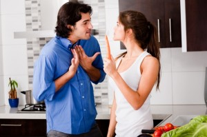 Young couple arguing in kitchen