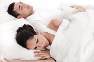 Young couple frustrated in bed