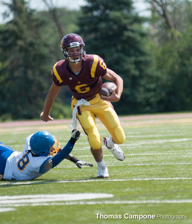 Peter Pujals breaks a tackle.
