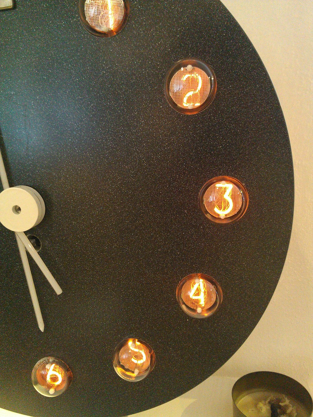 A clock, with the numbers made from bent light filaments