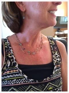 Theresa wears her 'chakra necklace""