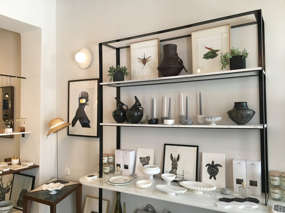 Shop at morethanthis - A stunningly designed shop filled with pieces by upcoming Greek designers. The perfect place to pick up gifts for the non-gimmicky-tchotchke people in your life including ceramics, paintings and jewelry. Created by Elena Xanthopoulou whom also designed the space.Visit Morethanthis