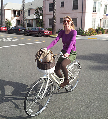 Me on my brand new bike! Note I've coordinated my outfit to my bike for my first outing on her.