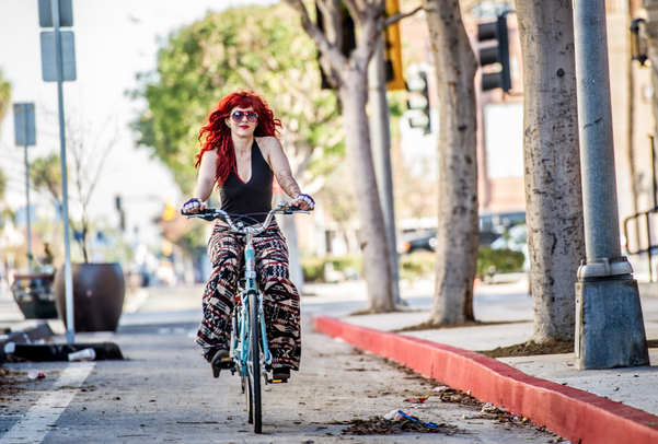 Yve Hart rides home in one of Long Beach's protected bike lanes. Image by Allan Crawford.