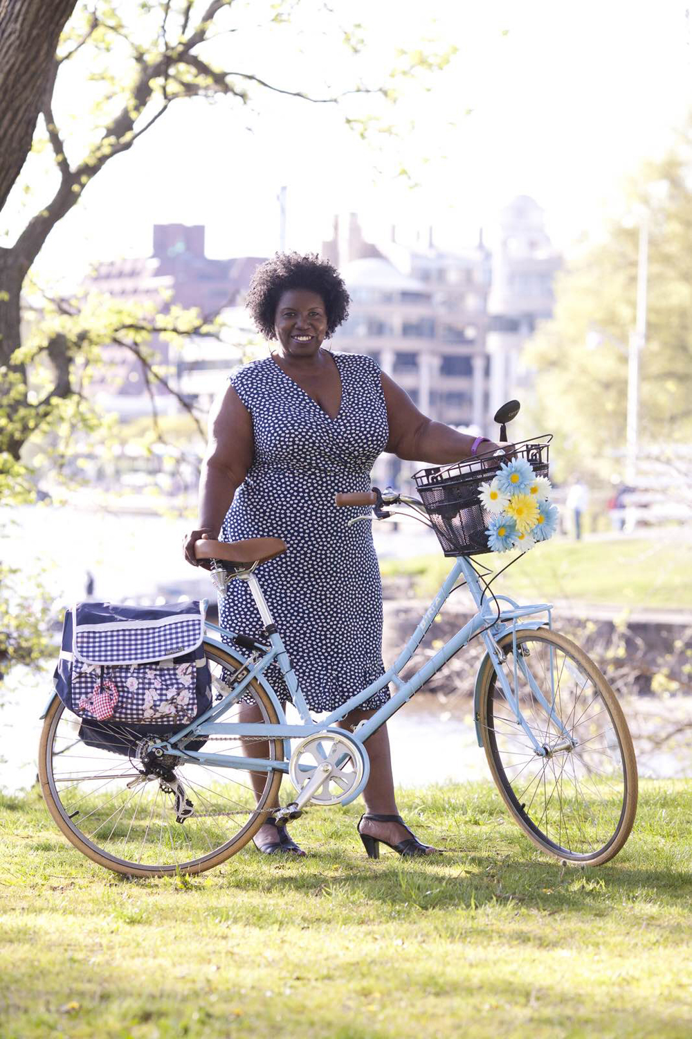 Yvonne rides a Biria with panniers by Basil and front basket by Sunlite.