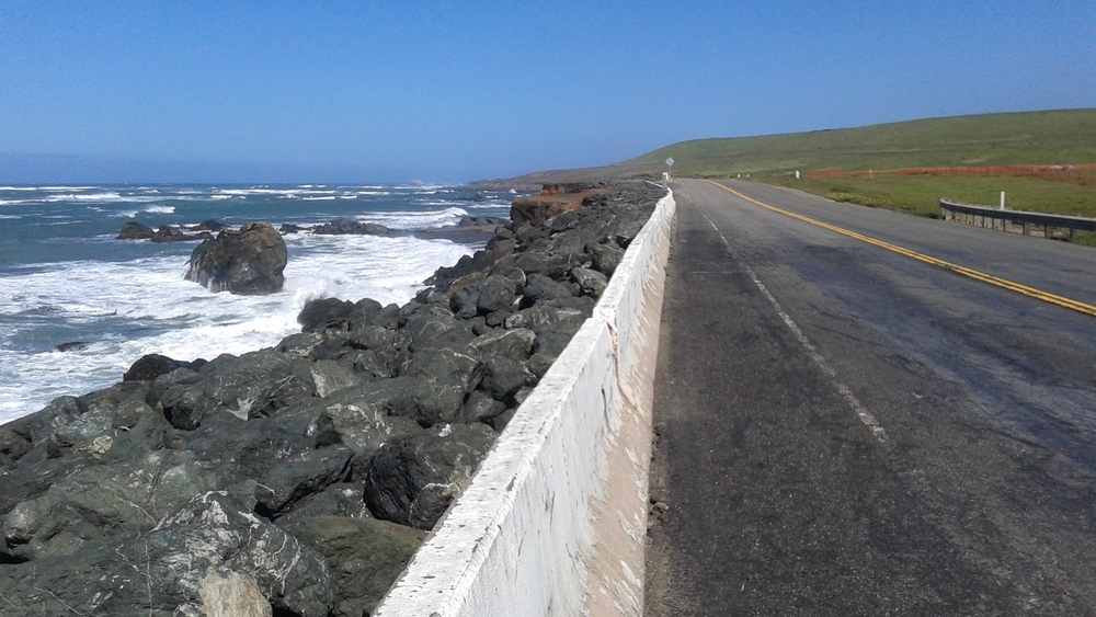Pacific Coast Highway near San Simeon moving inland, (see orange fencing), adapting to sea level increase