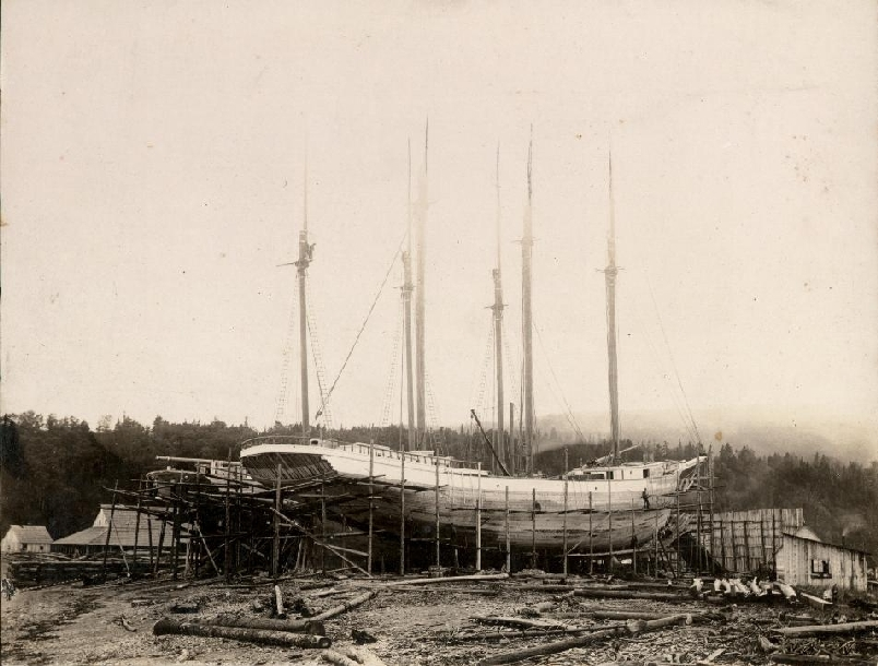 This photo is of the Meredith White under construction in Alma in 1918. The Meredith and its sister ship the Vincent (seen behind the Meredith) were built for C.T. White & Son Ltd. Note the scaffolding around the ships used by the men while building the vessel. Although the deck and the masts are in place the planks on the hull have yet to be painted.