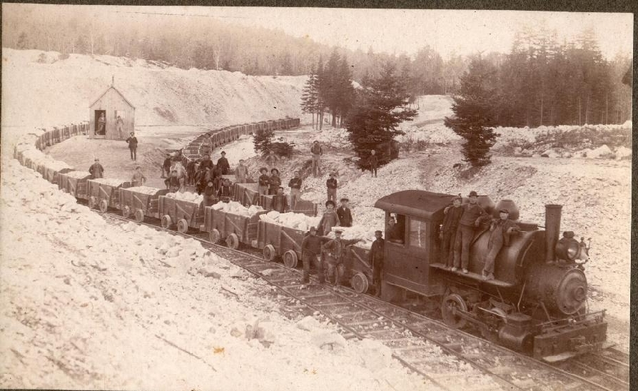 Engine 'Tad' hauling cars loaded with gypsum from the quarry to the mill.    1910