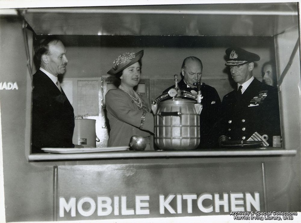R.B. Bennett with Queen Elizabeth in a mobile kitchen Circa 1942 England