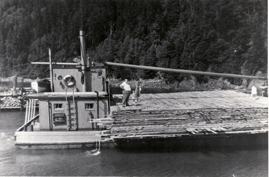 'The Manning' hauling a load of lumber from the wharf at Point Wolfe to a ship out in the Bay. 1915 Point Wolfe, New Brunswick, Canada