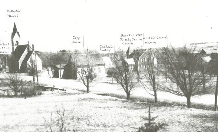 In this picture our house has been added to the back of the post office. To the far left is Delbert Wilbur's garage. Notice the steeple on the Catholic church.