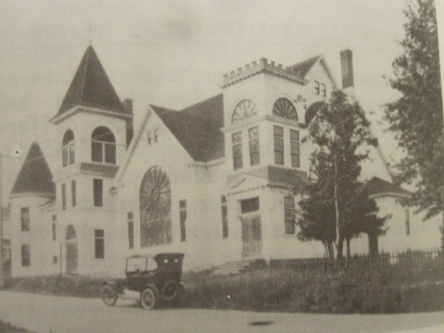 Model T Touring parked in front of the church on Main Street , Hillsborough. Not sure exactly how old the picture is.