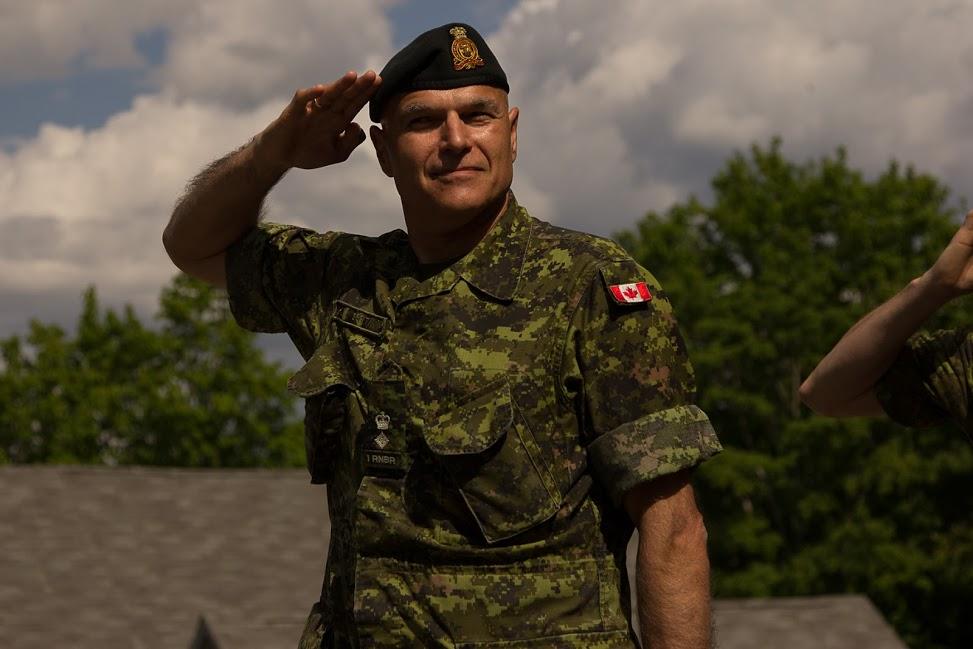 Lt Col Bertin RNBR giving salut to Br Gen Atkinson.jpg