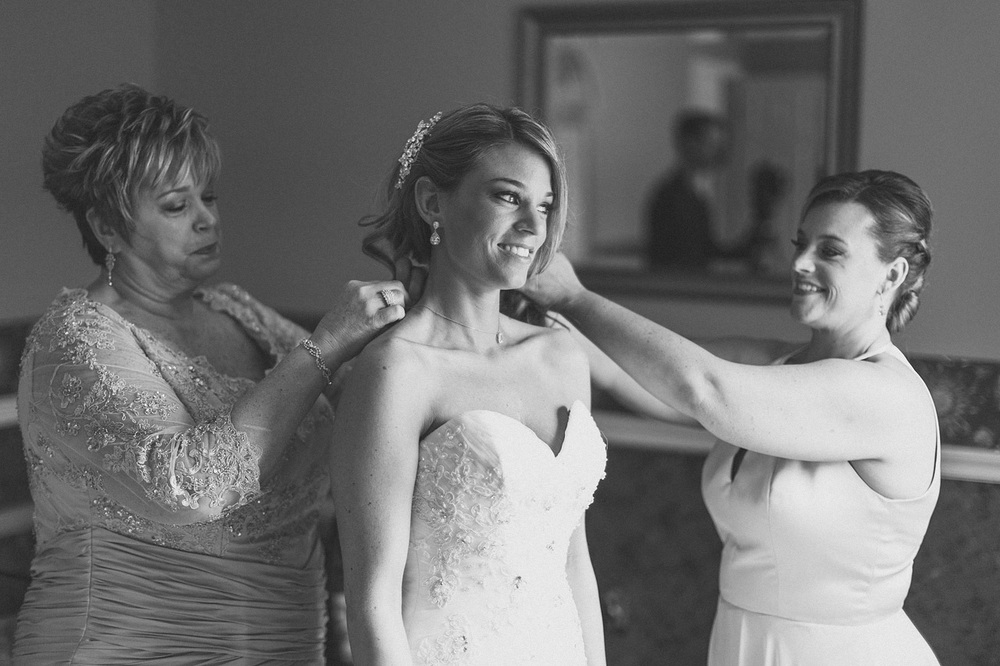 Mom and Sister help Bride